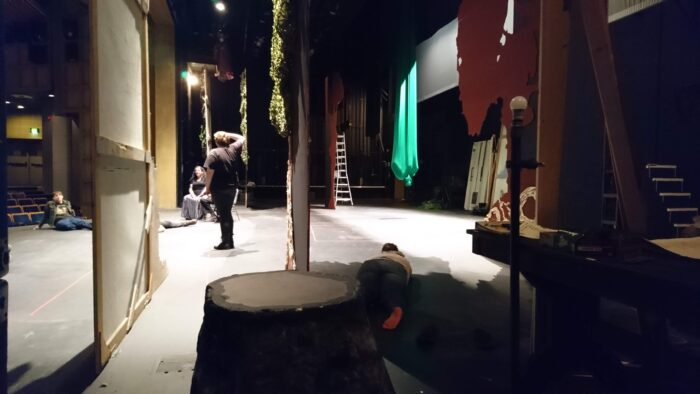 in the wings during rehearsal